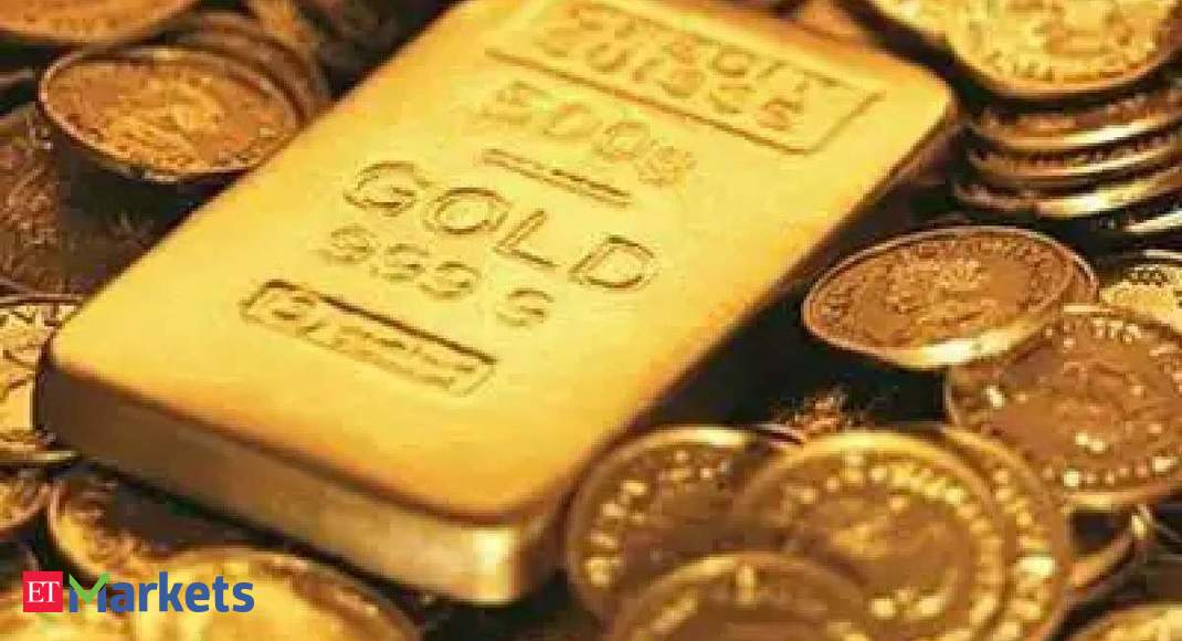 Gold futures gain on spot demand